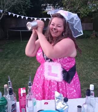 Hen shaking her cocktail
